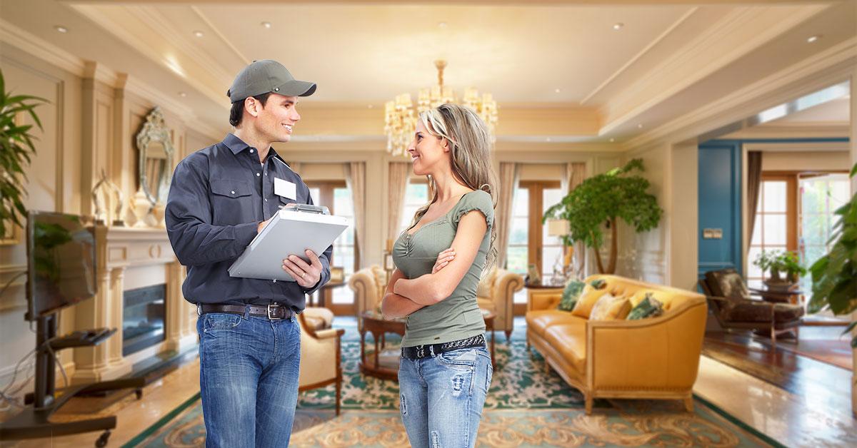 Customer and HVAC tech reviewing job
