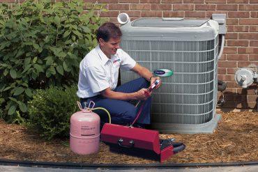 AC installation tech checks gauges in Pickerington